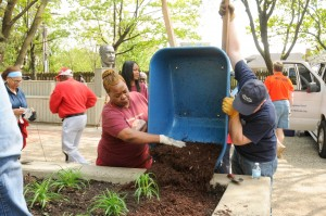 Putting down mulch at MLK Park
