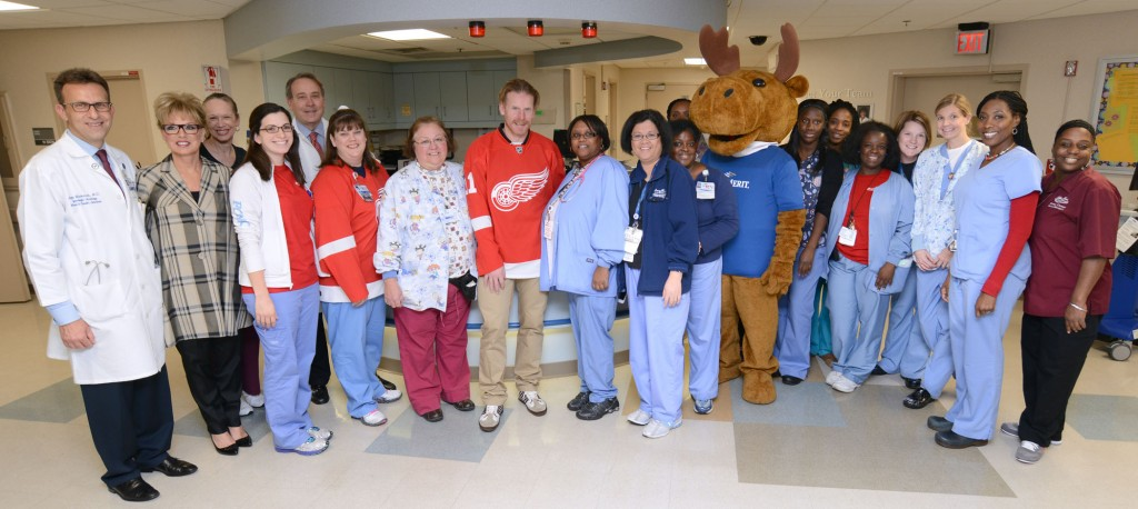 Dr. Munkarah, Sandy Pierce, Alfredsson and Franklin the FirstMerit moose with our team on H3.