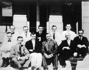The first Henry Ford Hospital staff. From left, first row (both shoes visible): Dr. Charles H. Watt, Dr. Frank J. Sladen, Dr. Roy D. McClure, Ernest G. Liebold, John N.E. Brown, and Dr. F. Janney Smith. Back row: Dr. John K. Ormond, unknown, Dr. Russell Haden, Dr. David R. Murchison, and Dr. Irvin L. Barclay. c. 1916 (Detail from the Conrad R. Lam Collection, Henry Ford Health System. ID=01.011.)